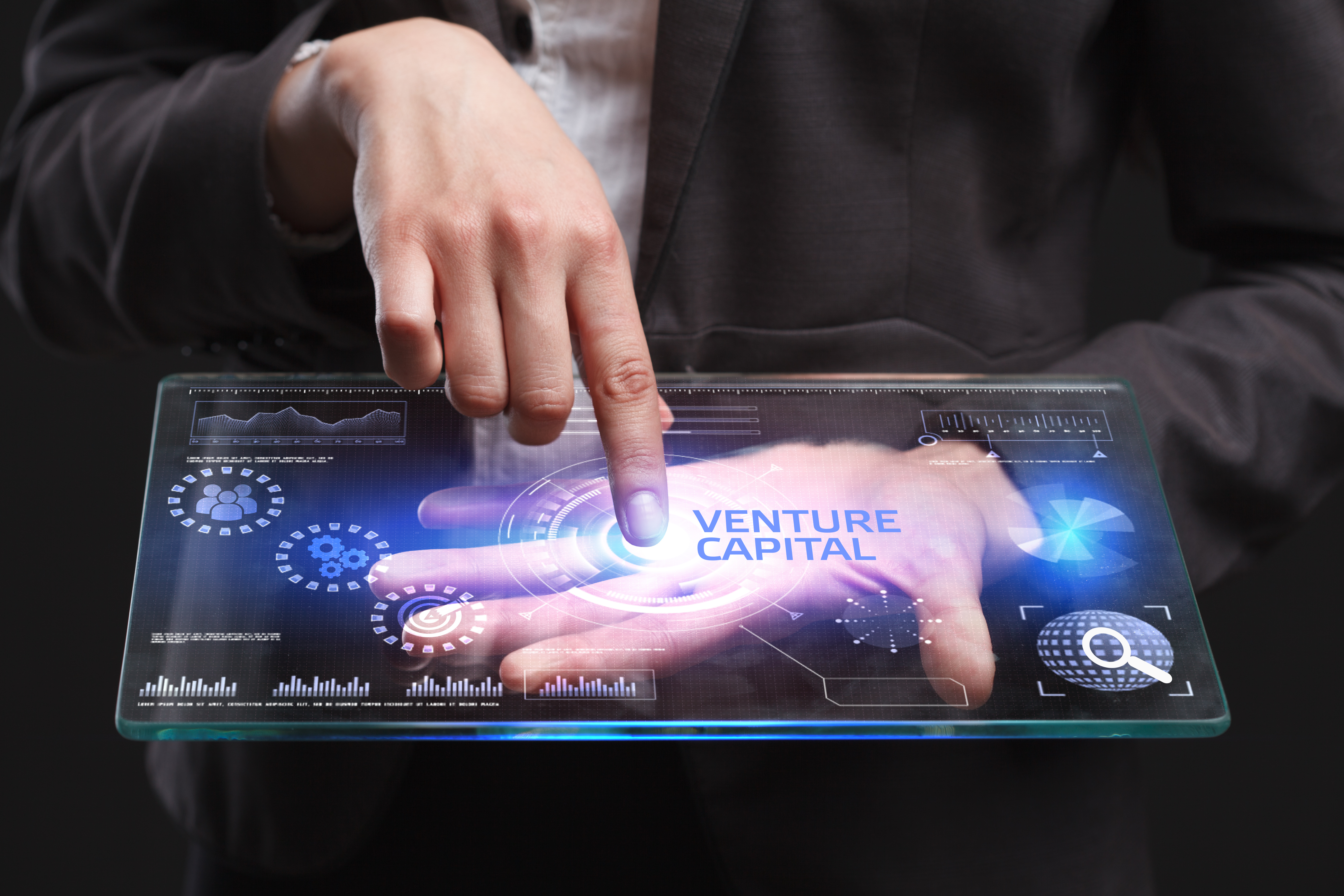 man pointing at venture capital on tablet screen