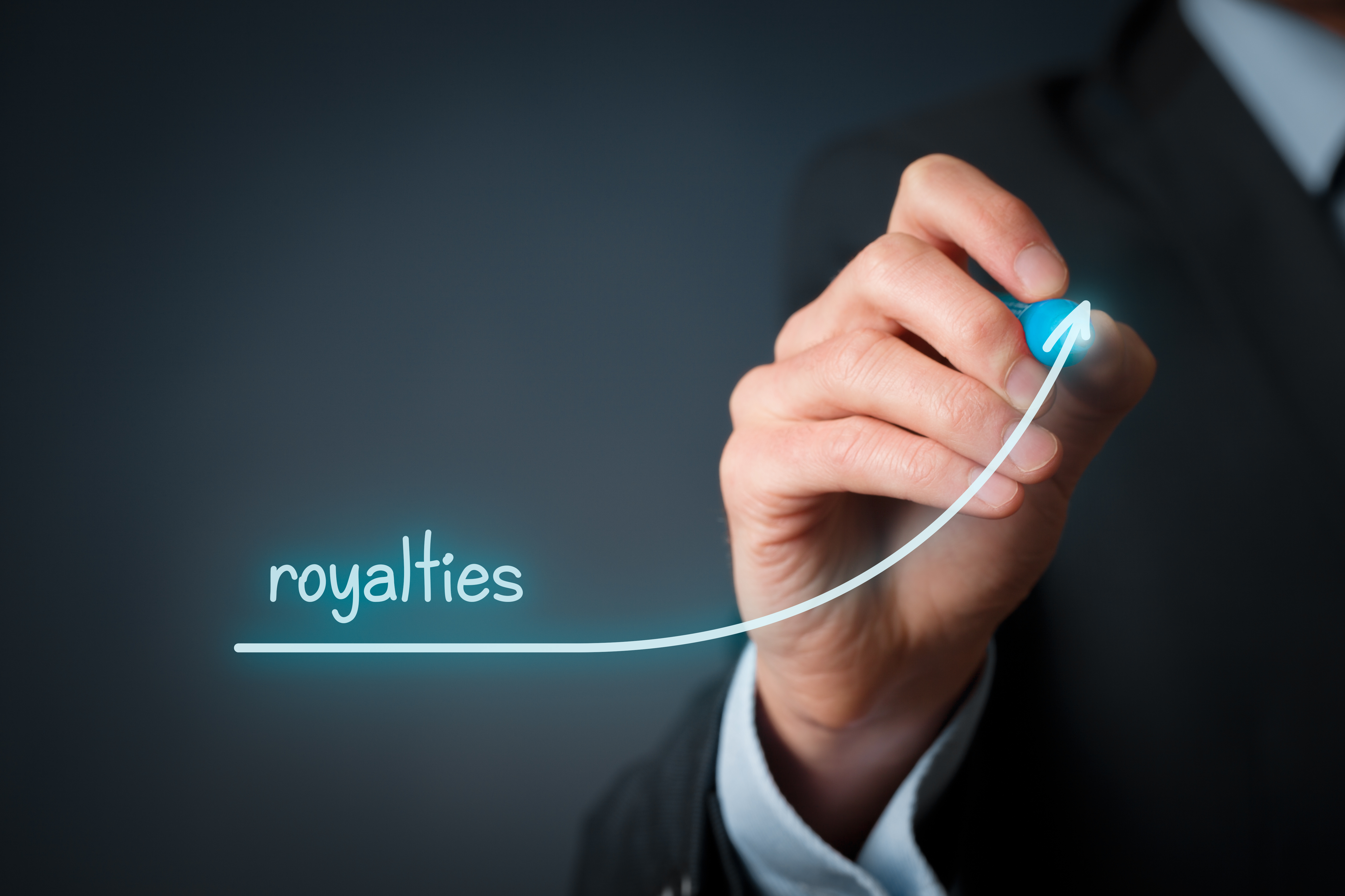 man drawing word 'royalty' with upwards arrow, royalty finance concept