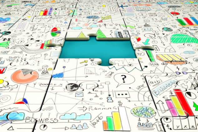 Missing piece of a puzzle with statistics drawn above, productivity puzzle concept