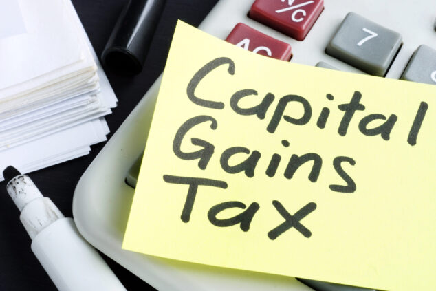 Capital Gains Tax written on Post-It note, CGT concept