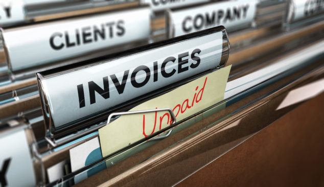 Filing cabinet with unpaid invoices file, chase debts concept