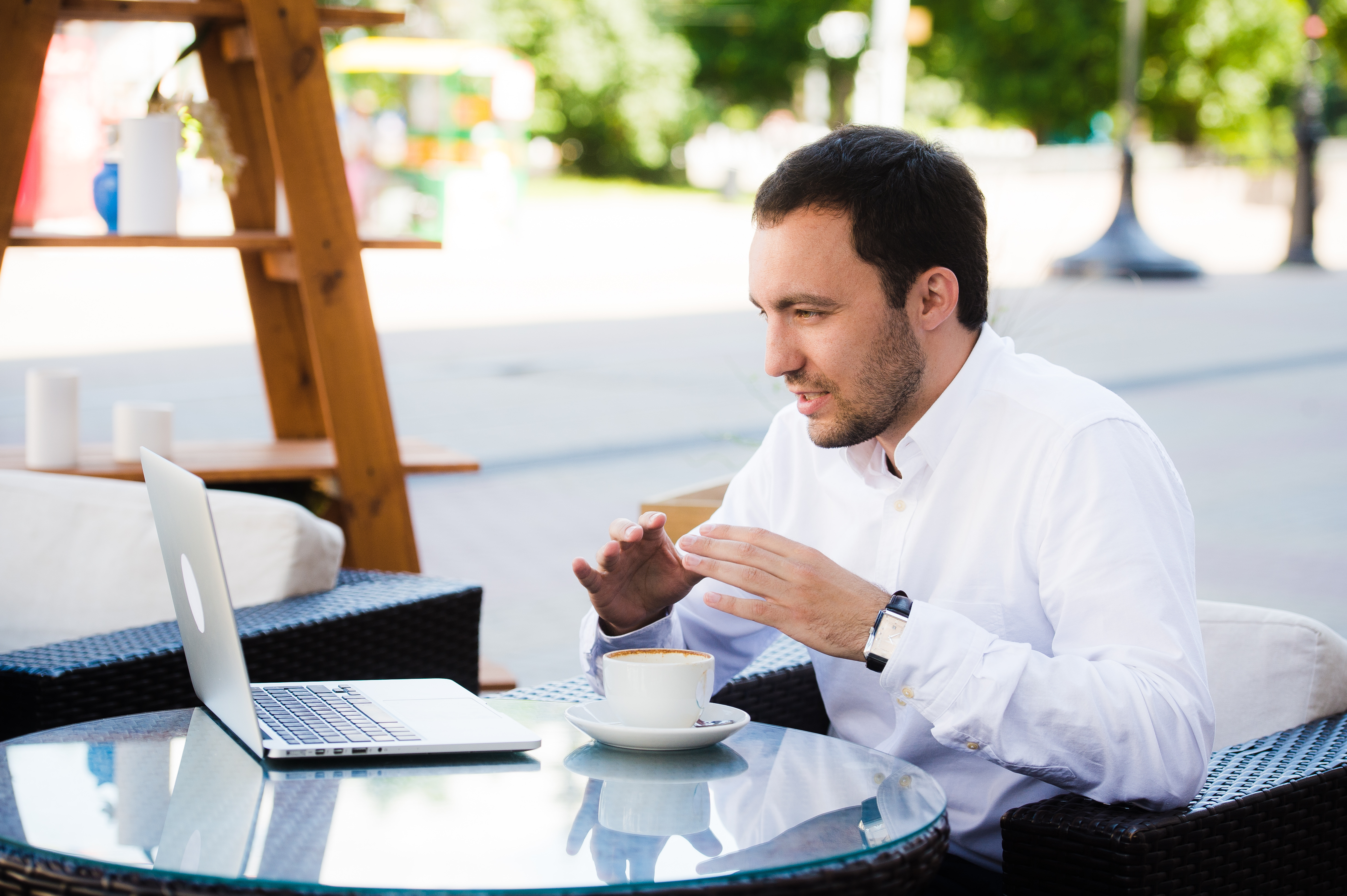 working remotely laptop half workforce cafe remote park outdoors dressed skype talking conference hotzone businessman relax shirt premium using business