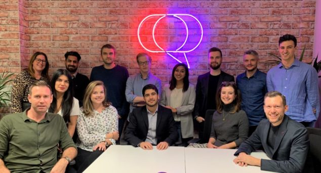 Stuart (first row, far right) and his team at Clear Review