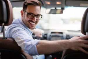 smiling businessman in car