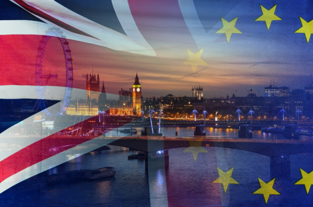 BREXIT conceptual image of London image and UK and EU flags overlaid symbolising agreement and deal being processed