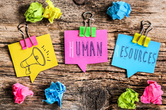 Words 'Human Resources' written on Post-It notes
