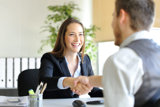 woman and man shaking hands, business loan documents concept