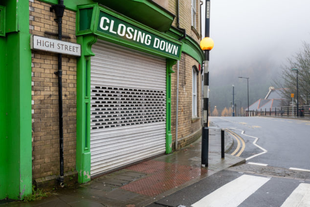 Bleak closed high street shop, corporation tax business rates concept