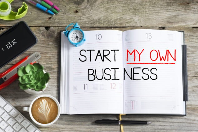 Start my own business written across inside pages of notebook, business recession concept