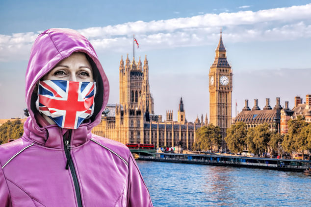 Woman in hoodie wearing Union Jack facemask, Tier 4 concept