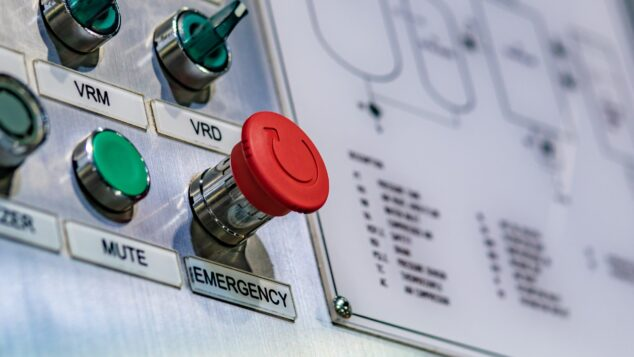 Emergency button on control panel,. businesses in distress concept